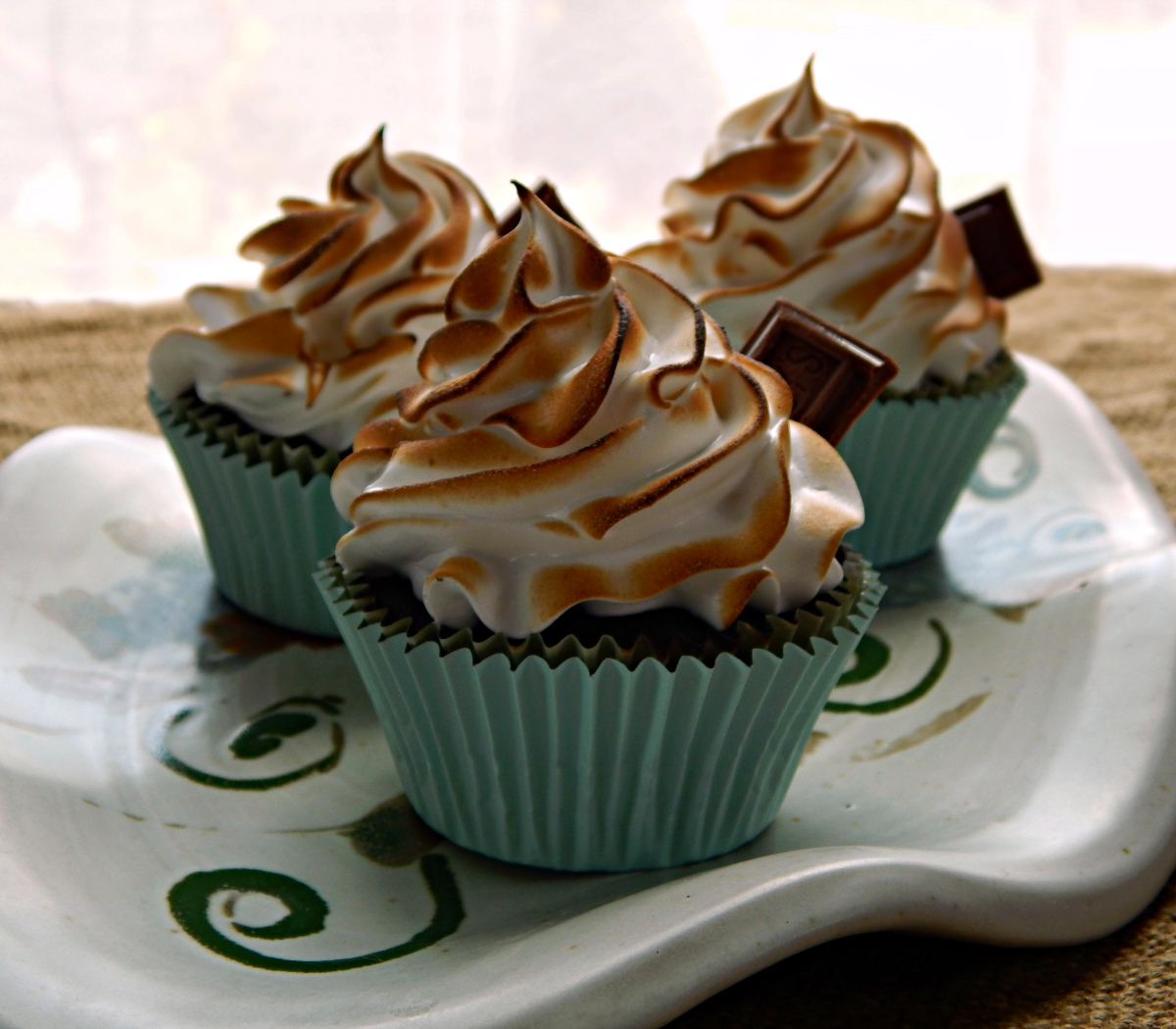 S'more Cupcakes with Swiss Meringue Frosting and truffle filling