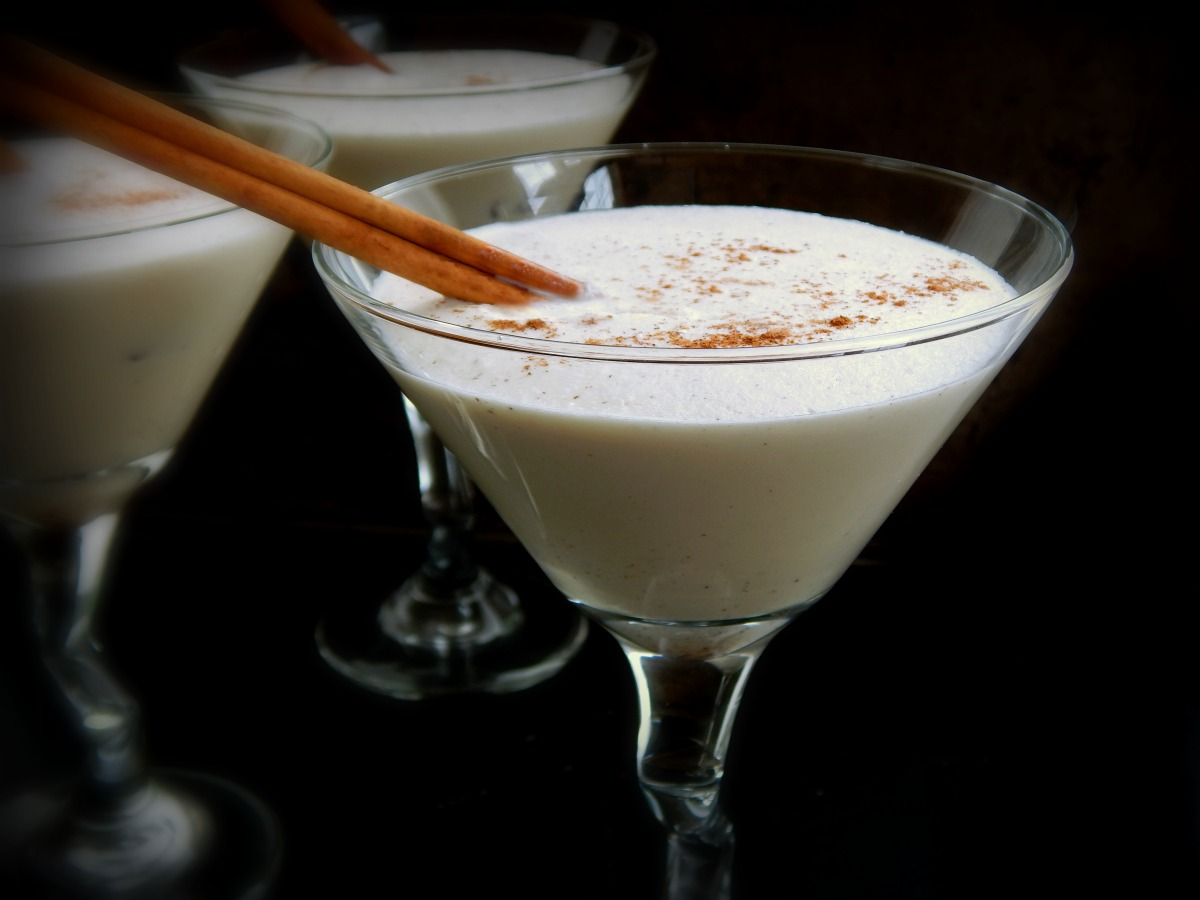 Coquito, a creamy, frothy coconut & rum cocktail