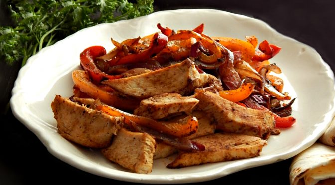 Super easy and fast, shortcut these fajitas with already cooked chicken. Great for using leftovers.